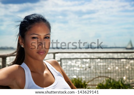 Pretty woman outdoors looking at cam - stock photo