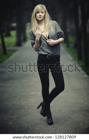 Pretty young girl posing in park