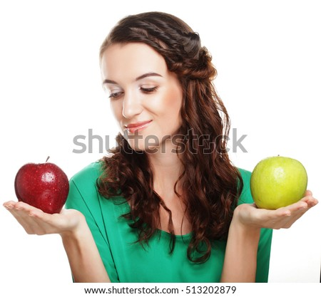 pretty young girl with the red and green apples
