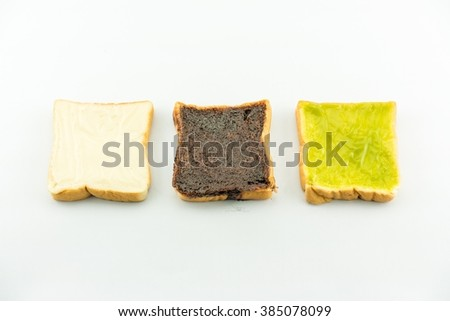 3 principle flavoured of bread : milk flavored cream spread bread slices and Sliced chocolate bread and Sliced thai custart bread isolate on white - copy space  - stock photo