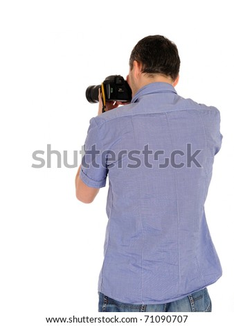 professional male photographer from back taking picture.copyspace . isolated on white background - stock photo