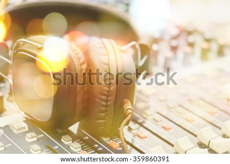 professional sound mixer with headphones - stock photo