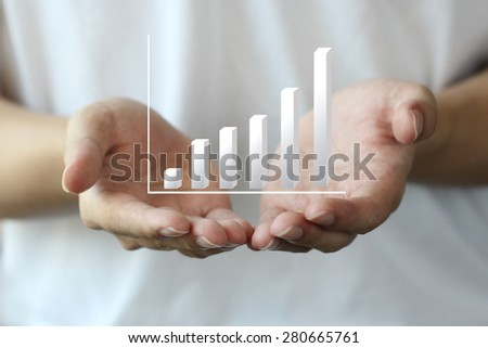 profit chart on hand, personal investment - stock photo