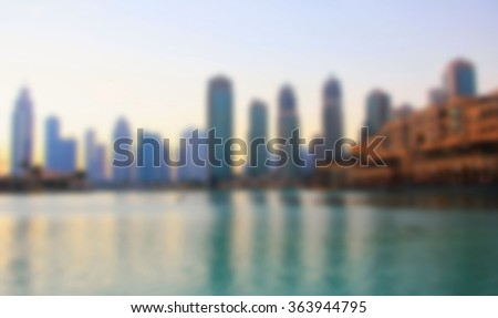 promenade singing fountains on the background of architecture, blurred - stock photo