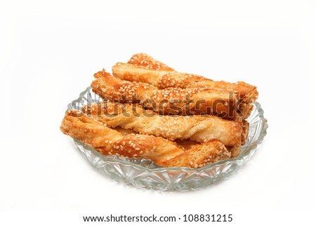 puff pastry sticks  with sesame seeds on white background - stock photo