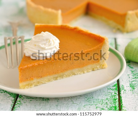 Pumpkin pie with whipped cream - stock photo