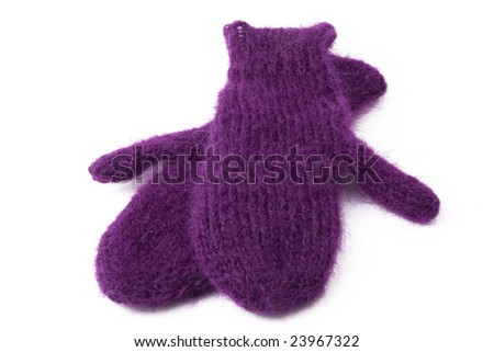 purple knitted gloves and cap on a white background - stock photo