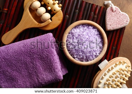 purple towel, lavender bath salts and relaxing bath accessories