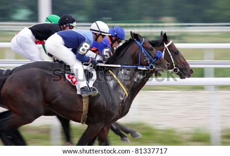 "PYATIGORSK, RUSSIA - JULY 10: Jockeys (L - R) Rustam Panzhokov and Yuriy Tikhonov race for the prize of ""Jockeys-kluba"" on July 10, 2011, in Pyatigorsk, Caucasus, Russia."