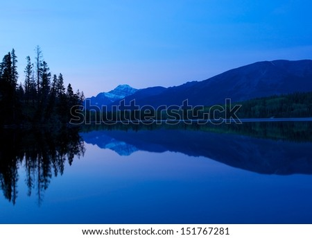 Pyramid Lake between dawn and sunrise in Jasper National Park, Alberta, Canada  - stock photo