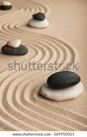 Pyramid  made of  stones standing on the sand, as background - stock photo