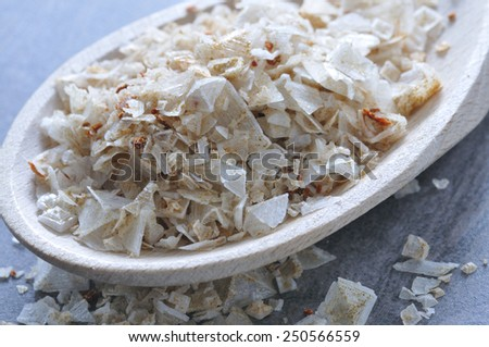 Pyramid salt with a wooden spoon. - stock photo