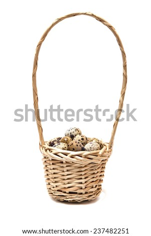 Quail eggs in a basket on a white background.