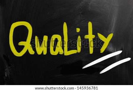 """""""Quality"""" handwritten with white chalk on a blackboard - stock photo"""