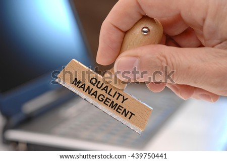 quality management printed on rubber stamp - stock photo