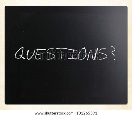 """""""Questions?"""" handwritten with white chalk on a blackboard. - stock photo"""