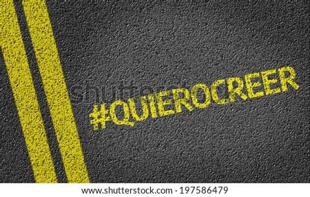 #QuieroCreer written on the road (in spanish) - stock photo