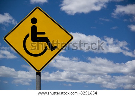 """Wheelchair&qu ot; disabled road sign against a blue sky background - stock photo"