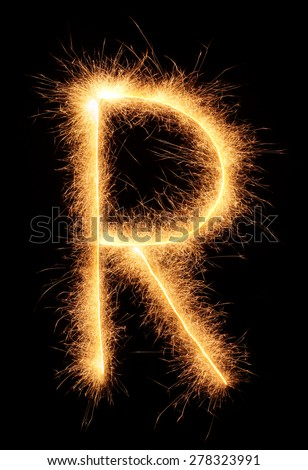 """R"" letter drawn with bengali sparkles isolated on black background - stock photo"
