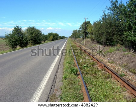 Railway and parallel asphalt road
