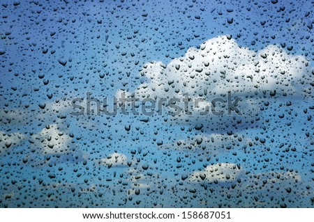 Rain drops on a car windshield                              - stock photo