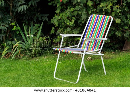 Rainbow colour striped Deck Chair on lawn