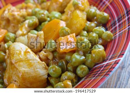 ��rakos  - greek cuisine.green peas with tomato sauce and potatoes. - stock photo