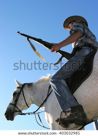 ranger horseback riding, low angle view - stock photo