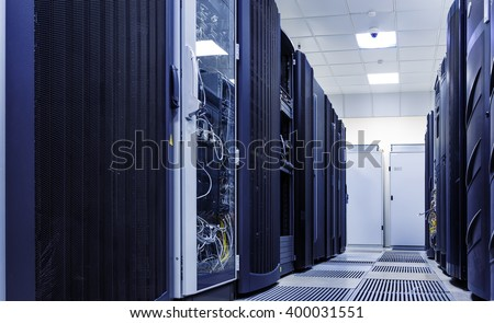 ranks of modern server hardware in data center - stock photo