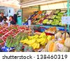 RAVENNA, ITALY MAY 21: fruits and vegetables vendor at the Wednesday outdoor market. The place is very popular in the city and attracts thousands of people. May 21, 2005 Ravenna Italy - stock photo