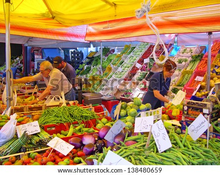 _ RAVENNA, ITALY MAY 21: vegetables vendor at the Wednesday outdoor market. The place is very popular in the city and attracts thousands of people. May 21, 2005 Ravenna Italy - stock photo