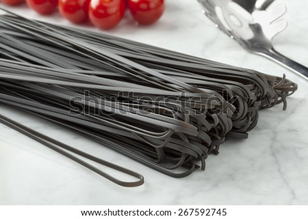 Raw black tinted traditional Italian spaghetti  - stock photo