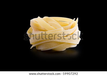 raw dry nest pasta with reflection isolated on black - stock photo