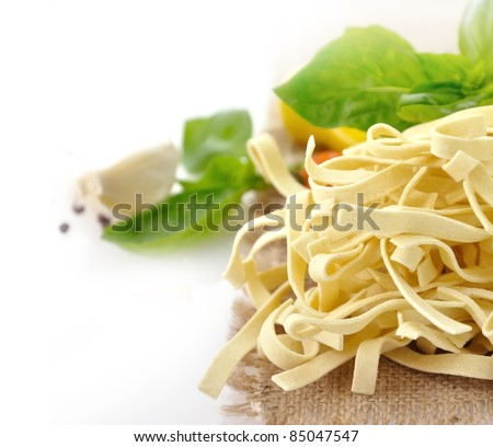 Raw Italian Pasta With Spices , Close Up - stock photo