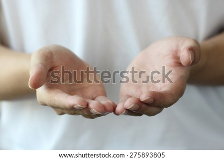 reaching cupped hands - stock photo