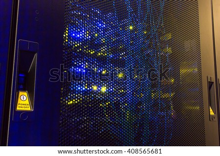 rear of the rack server switching equipment illuminated from within - stock photo