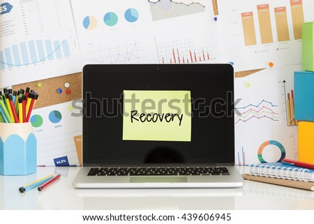 RECOVERY sticky note pasted on the laptop screen - stock photo
