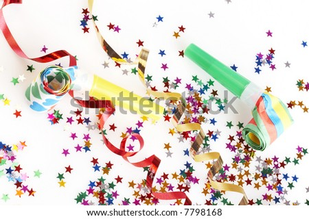 red and golden spirals, small confetti stars and colorful blowers on white background, party time - stock photo