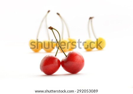 Red and yellow cherries isolated on white background - stock photo