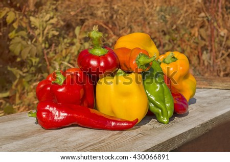 Red and yellow pepper on a wooden background