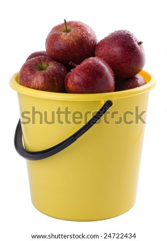red apples in a yellow bucket, isolated on white background.