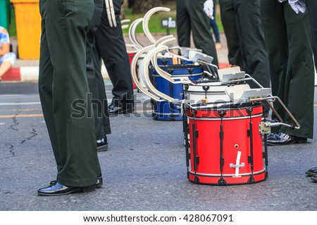 Red  Bass Drum are  in Parade waiting for Marching Band to perform - stock photo