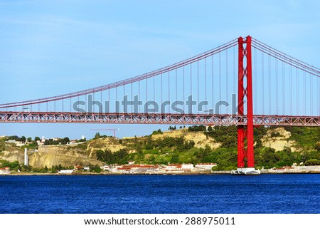 Red bridge over the Tagus river in Lisbon, Portugal. - stock photo