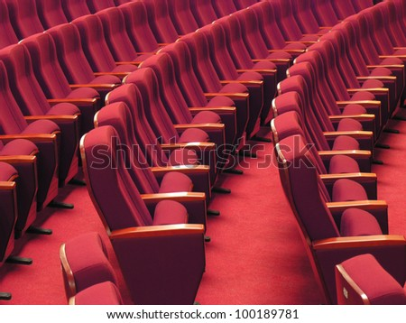 red chairs in the hall - stock photo