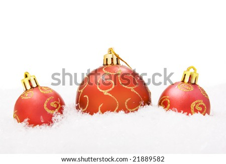 red Christmas balls in snow