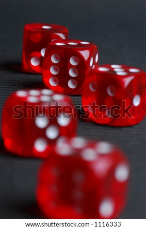 5 red dice on black