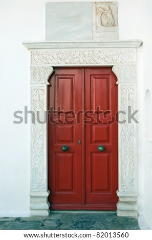 Red door museum, surrounded by marble. - stock photo