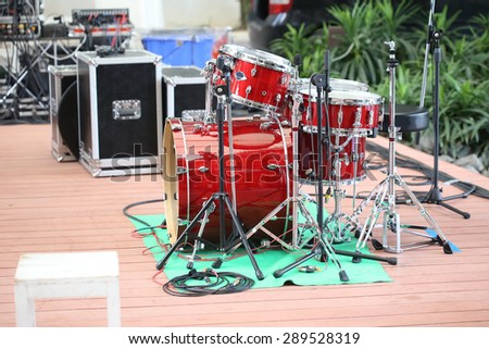 red drum set ,view on two drums and plates kit with wood visual appearance , concert stage - stock photo