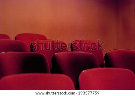 Red empty theater seats. Shallow DOF.