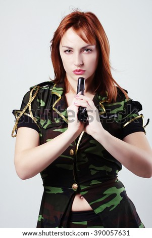 red-haired girl in military uniform - stock photo